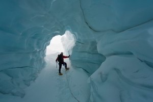 Exploring an ice cave, Ruth Glacier, Central Alaska Range