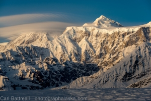 Denali is often capped with a cloud. Denali creates its own weather and tourist have about a 30% chance of a clear enough day to see the mountain's summit.