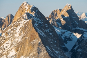 Cathedral Peaks (triple peak on the left) and Kichatna Spire (on the right)