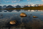 Unnamed mountains reflected in Lima Bean Lake (local name), central Alaska Range