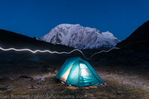 Setting up the tent as the last light fades on Mount Moffit