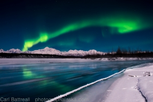 Aurora over Denali and the Chulitna River on a full moon night.