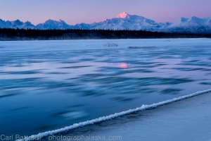 Moving river ice and the last light on Denali.