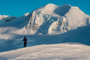 Brad enjoys the last light on the beautiful north face of peak 7680.
