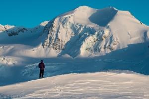 Brad enjoys the last light on the beautiful north face of peak 7680.